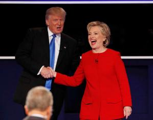 Republican U.S. presidential nominee Donald Trump shakes hands with Democratic U.S. presidential nominee Hillary Clinton at the conclusion of their first presidential debate at Hofstra University in Hempstead, New York, U.S., September 26, 2016. REUTERS/Mike Segar - RTSPKRA