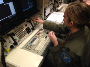 This photo taken Jan. 9, 2014 shows Capt. Lauren Choate, a Minuteman 3 missile launch officer, at the console of a launch simulator used for training at F. E. Warren Air Force Base, Wyo. As disclosures of disturbing behavior by nuclear missile officers mount, to now include alleged drug use and exam cheating, Air Force leaders insist the trouble is episodic, correctable and not cause for public worry. The question persists, nonetheless: At what point do breakdowns in discipline put nuclear security in jeopardy? (AP Photo/Robert Burns)